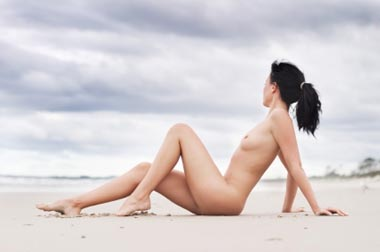 nudist lady lying on beach